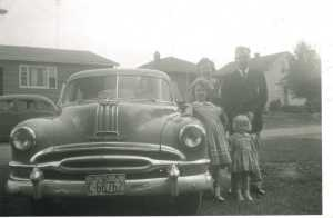 My family beside our first car, made possible by our father's job at GM.